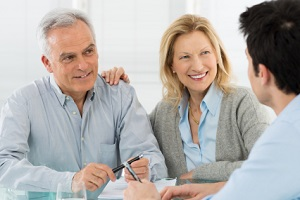 Senior Couple learn to create financial success with advisor