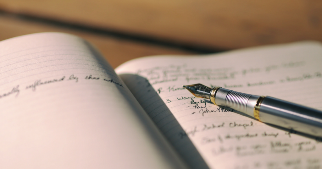 Inkwell pen on paper to make a list of lifetime goals, by jack canfield