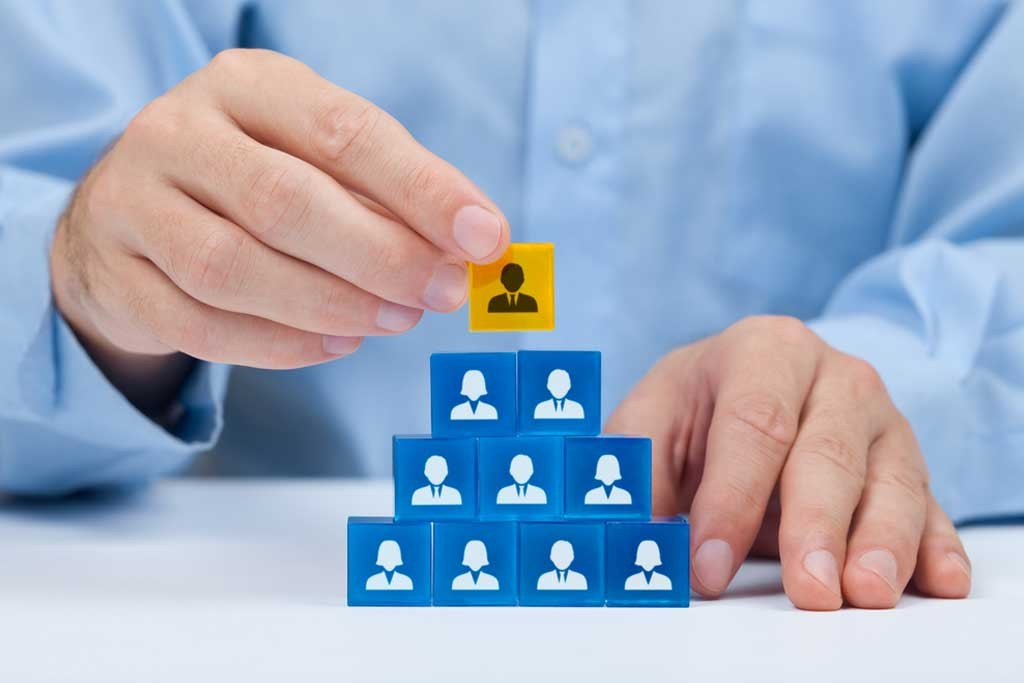 sales manager stacks business training blocks like a growing business