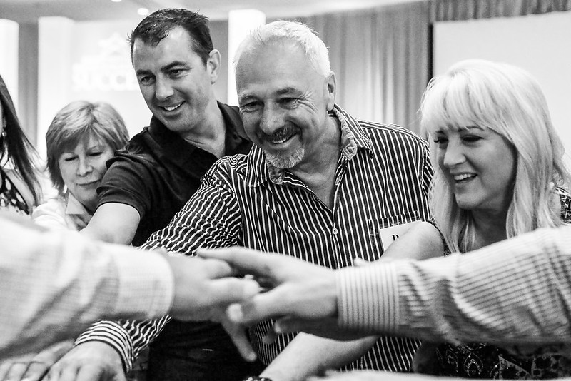 jack canfield teaches how to believe in yourself with a group huddle and break