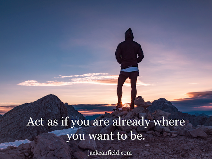 act as if you are already where you want to be, quote by jack canfield, man standing on a mountain at sunset